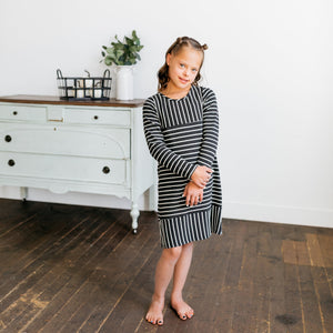 Baby Girl Clothes: model holding her hands to the side