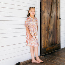 Baby Girl Clothes: leaning up against shiplap wall