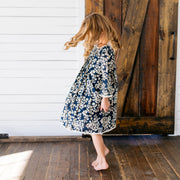 Baby Girl Clothes: girl spinning in flower dress