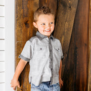 Baby Girl Clothes: boy leaning up on door