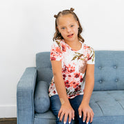 Baby Girl Clothes: model sitting with floral shirt