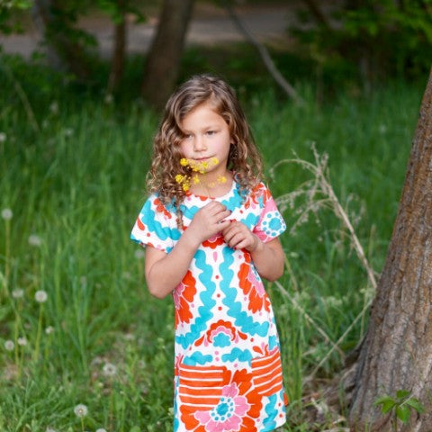 Girl Smelling Flowers in Flower Dress: Baby Girl Clothes