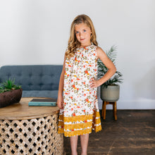 Baby Girl Clothes: girl standing by table