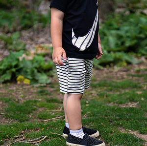 Boy in Nike shirt and striped shorts: Baby Girl Clothes