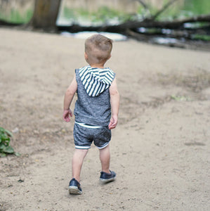 Boy Struts away from the camera: Baby Girl Clothes