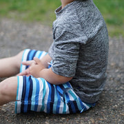 Boy sits down on pavement: Baby Girl Clothes
