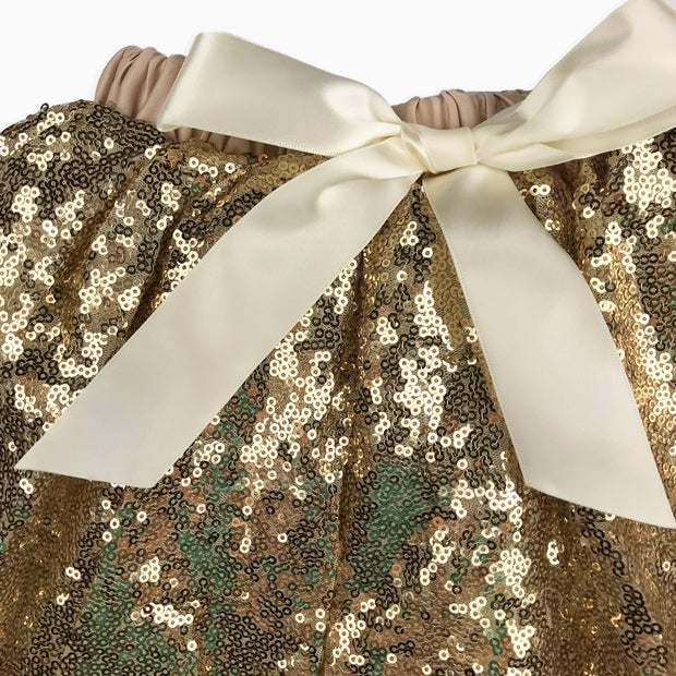 Baby Girl Clothes: close up view of gold bow