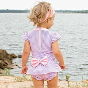 Little Girl Stares into Water in Swimsuit: Baby Girl Clothes