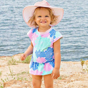 Girl Smiling at camera with flower swimsuit: Baby Girl Clothes