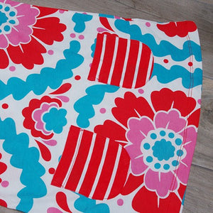 Close up of Striped Pockets on Flower Dress: Baby Girl Clothes