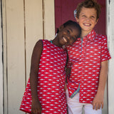 TukTuk Designs girls nautical red shift dress with white shark print and blue trim with two side pockets. Available matching boys, sibling shirt .