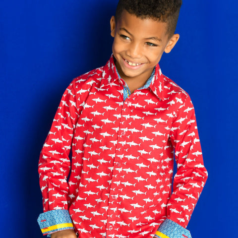 TukTuk Designs Boys shirts in a fun red mako shark print, designed to spark the imagination of little minds. Thoughtfully tailored in small batches and with fine detailing for stylish little gentlemen. Perfect for beach vacations, holidays, parties and memorable moments for the shark-obsessed! Available in matching girls dress.