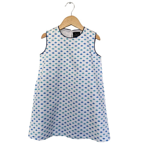 TukTuk Designs girls nautical origami sailboat shift dress with blue and green delicate sailboats, blue trim and side pockets. Available matching boys, sibling shirt .