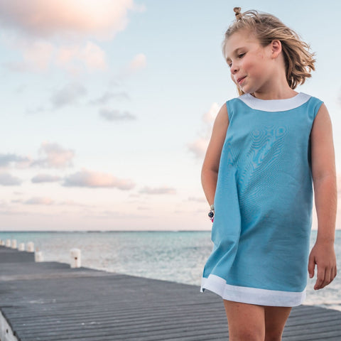 TukTuk Designs girls classic shift dress in ocean blue with white trims and side pockets. Perfect for the beach, play dates and everyday.