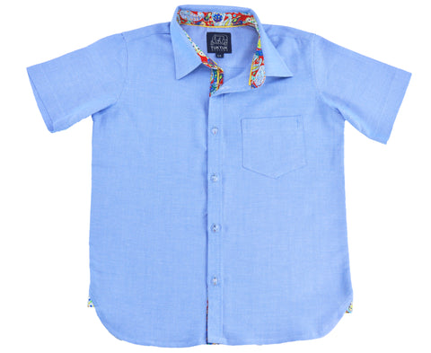 TukTuk Designs Boys shirts in chambray, designed to spark the imagination of little minds. Thoughtfully tailored in small batches and with fine trim detailing. Perfect for vacations, parties and memorable moments in between.
