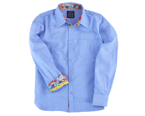 TukTuk Designs long sleeve boys button up chambray, denim blue shirt with colorful contrast trim detail.