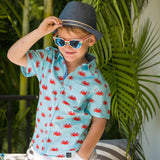 TukTuk Designs Boys short sleeve tailored shirts in fun crab print with contrast wave trim. Perfect for beach vacations, resorts and everyday memories. Available in matching girls dress.