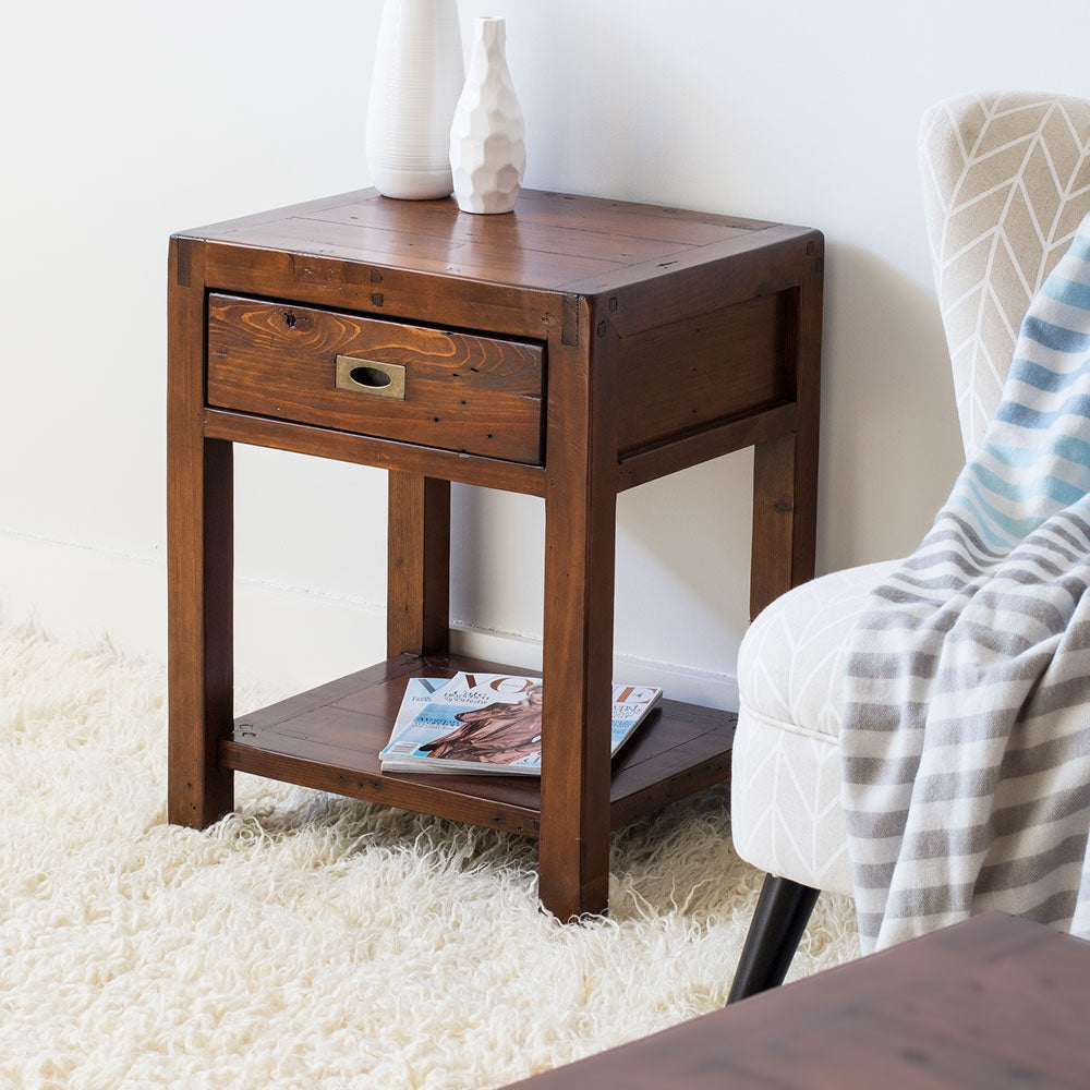 brown wood lamp table on shaggy rug