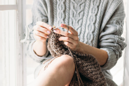 Women's hands knitting