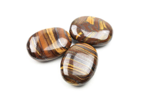 Large Banded Tiger's Eye Palm Stones. The Golden color energy of Tiger's eye resonates with the Solar Plexus Chakra. One of the most popular stones for healing the solar plexus.
