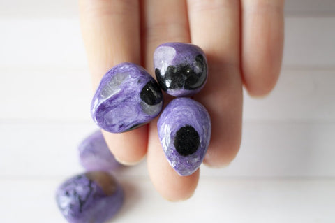 charoite stones with black spots