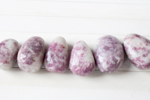 large purple and white lepidolite stones