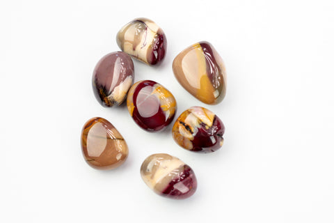 Multi Colored Mookaite Tumbled STones. The golden shade of Mookaite particularly resonates with the solar plexus.