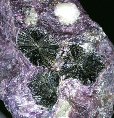 raw charoite with black aegirine inclusiones