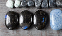 Genuine Larvikite stones with royal blue flash.