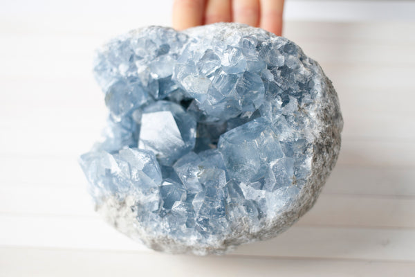 Celestite, also known as Celestine, is a mineral that forms blue crystals. Celestite is often associated with divine power and is thought to increase understanding, higher consciousness, as well as mindfulness when used in meditation and prayer.