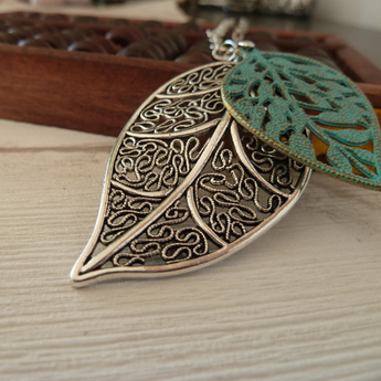 Silver and green leaves necklace