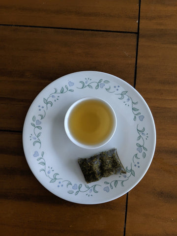 Lakyrsiew green tea, brewed in a cup