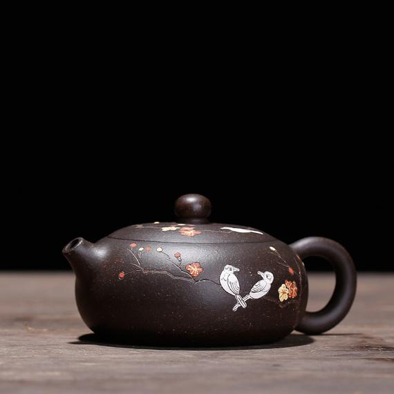 Yixing clay teapot with Chinese carving and handiwork