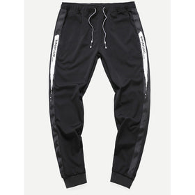 Men Tape Detail Letter Print Drawstring Pants