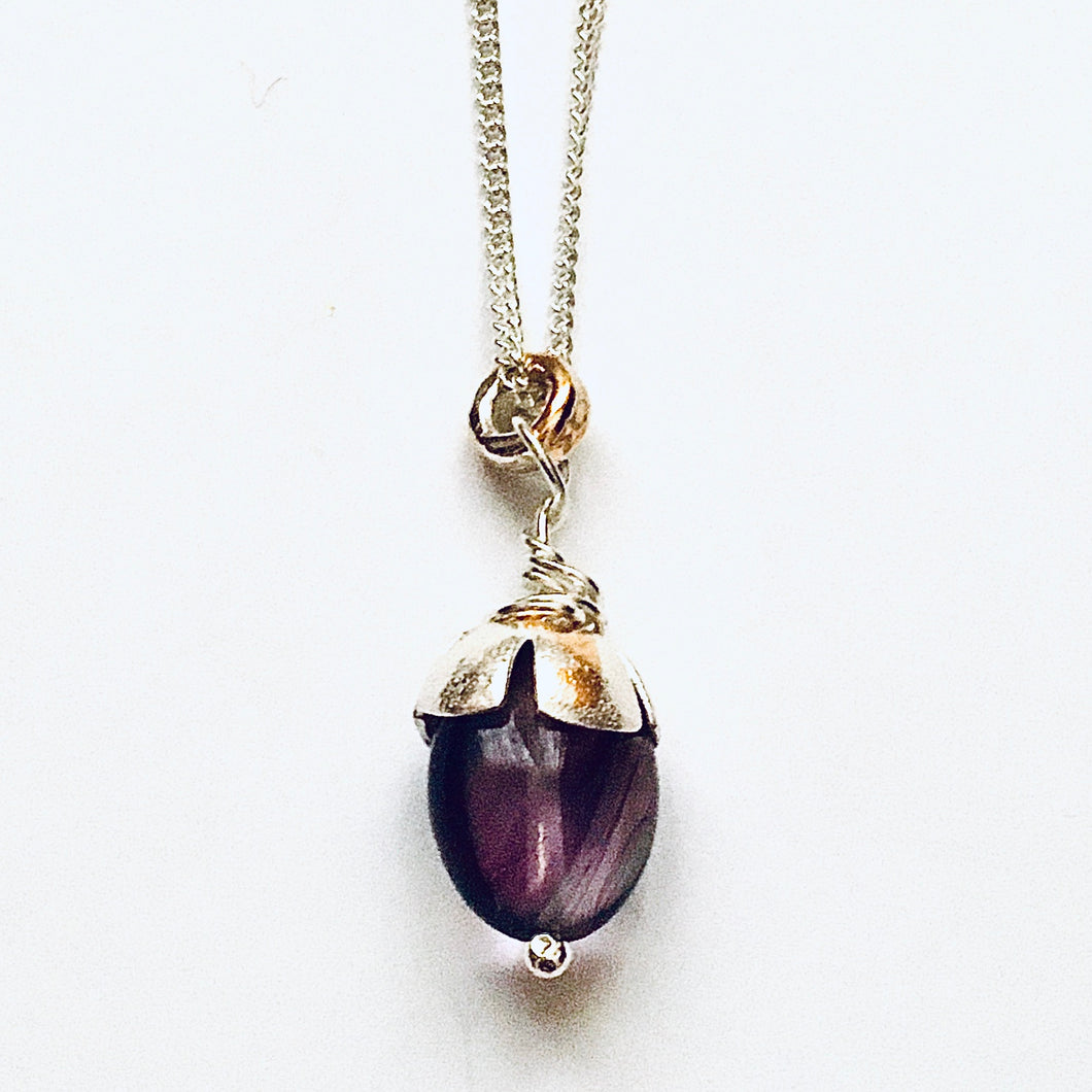 Silver, gold detail and fluorite acorn pendant