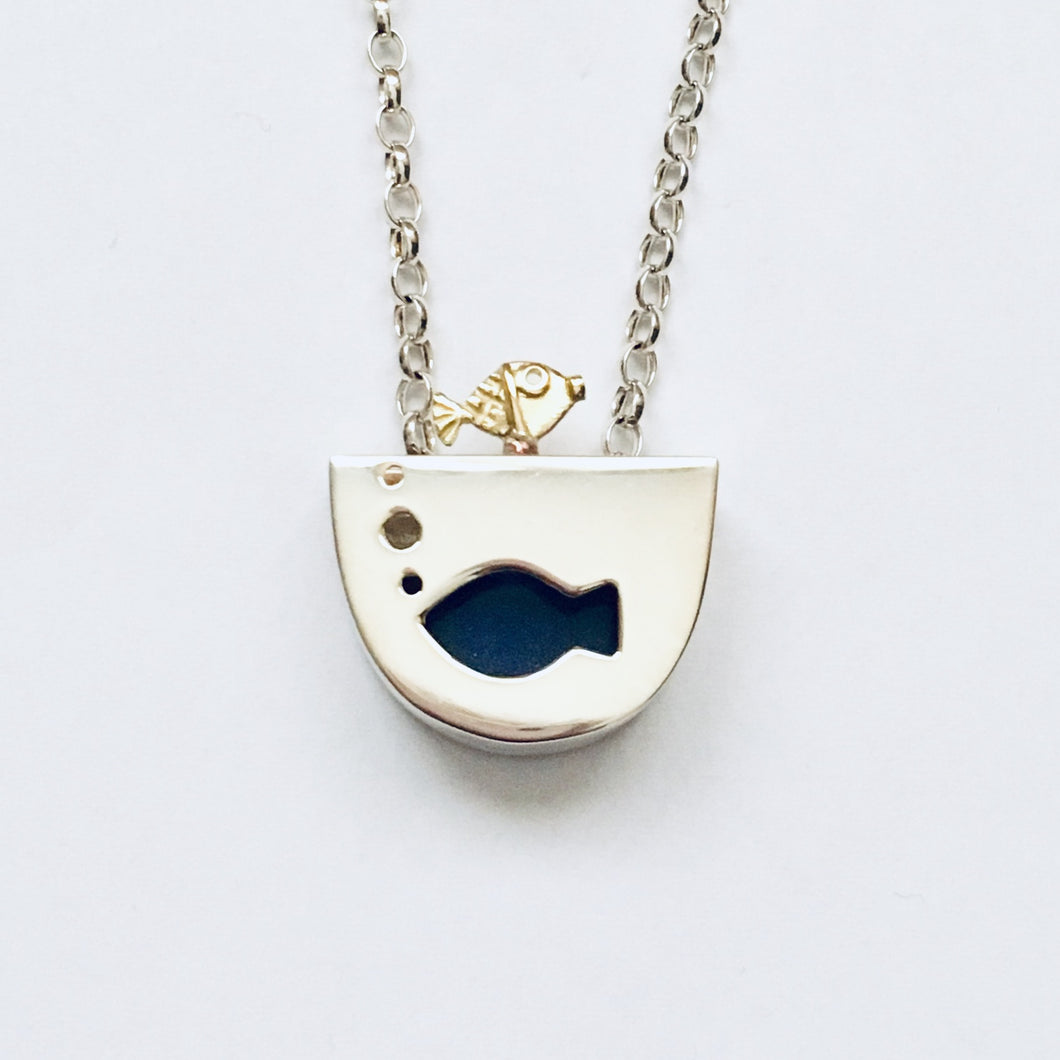 Silver and 18ct gold moving fish pendant