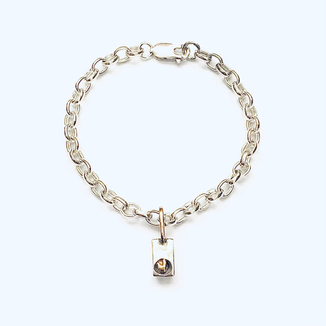 Silver and 9ct gold heart bracelet