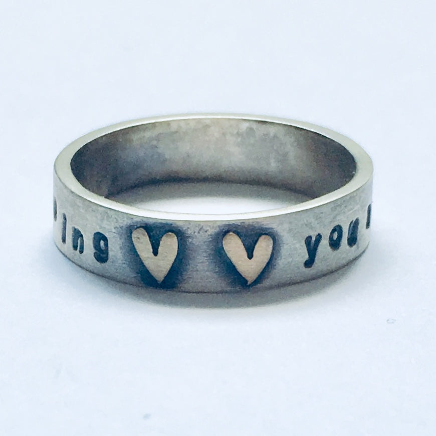 "Silver and 9ct gold ""you make me feel like dancing"" ring"