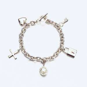 Silver and freshwater pearl charm bracelet