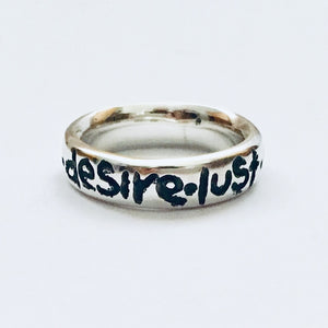 "Silver ""love desire lust chocolate "" ring"