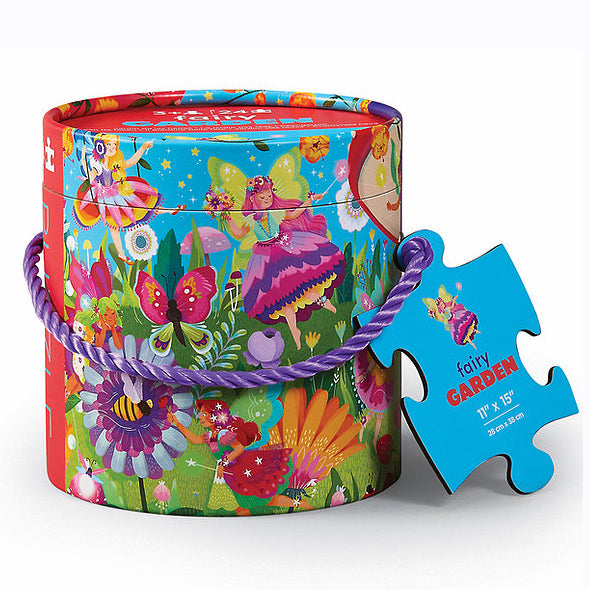 Fairy garden jigsaw puzzle with beautifully illustrated artwork on both puzzle and the tube shaped storage box.
