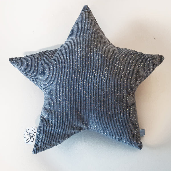 The Star cushion from Picca Loulou will add a delightful finishing touch to a nursery or bedroom. In plush soft grey corduroy.