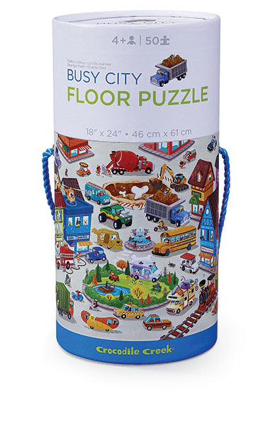This 50-piece puzzle depicting a busy city scene is a high - quality floor puzzle in wonderful, heavy-duty, contour-shaped gift box.