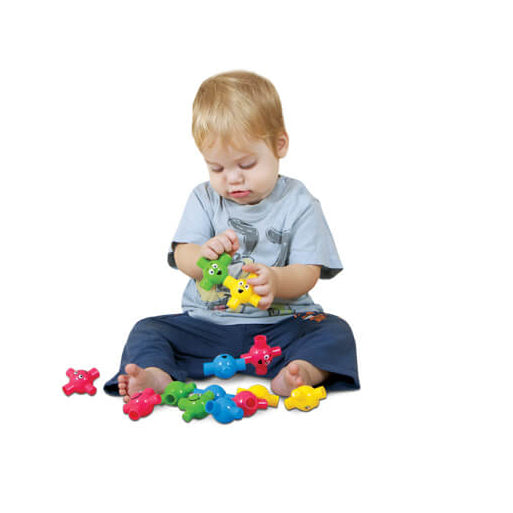 Colorful soft and rubber snap construction set exclusively designed to encourage young children in developing fine motor skills and guarantee hours of fun.