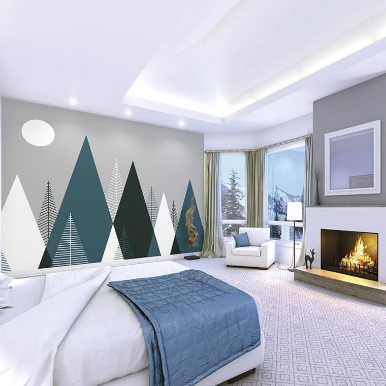 This fresh scandinavian style Mountainscape wall mural will make any room of the home feel more spacious and clean. With triangle mountains and pine trees in toned colours of teal blue and soft whites on a saturated grey night sky, this sleek wall mural would be perfect in a modern bedroom.