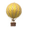 Small yellow hot air balloon which comes complete with a rattan basket hanging from hand-knotted netting.