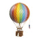 Large rainbow hot air balloon which comes complete with a rattan basket hanging from hand-knotted netting.