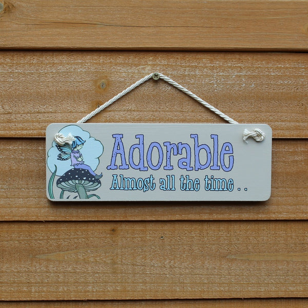 "Rooms for Rascals wooden sign / door hanger ""Adorable Almost all the Time"" with a picture of a fairy sitting on top of a mushroom"