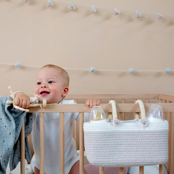 The Maria Basket is a brand-new basket by Lorena Canals. This is a perfect, practical basket to hang in the crib. The braided cotton basket in oval shape will help you have ready all that your baby needs.