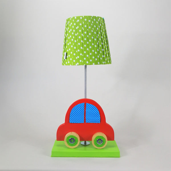 Colourful side lamp with a lime green wooden base, a cartoon-like red car design and a lime green lampshade.
